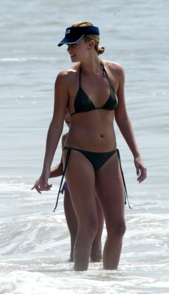 In August 2003, Charlize Theron wore a bikini to the beach in Malibu.