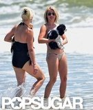 Bikini-clad Julianne Hough carried her dog into the water in Oak Island, NC.