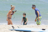 The family that surfs together . . . Ben Stiller and Christine Taylor hung out with son Quinlin on the beach in Kauai.