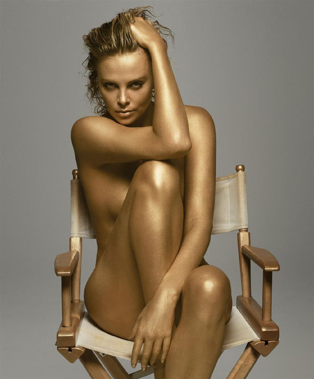 Charlize Theron went for the gold while posing nude for Dior's J'adore fragrance in September 2011. Source: Dior