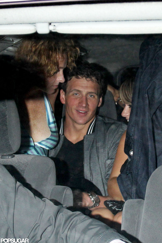 Ryan Lochte had a female friend on his lap leaving a London nightclub.
