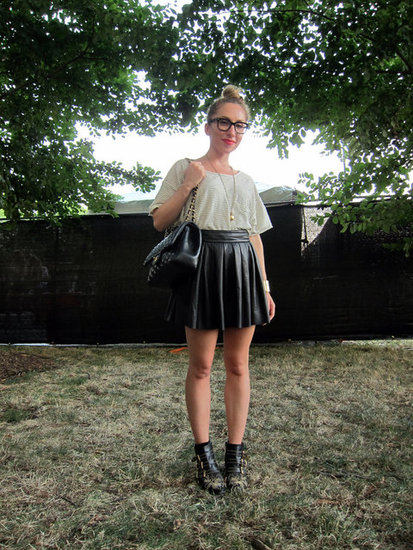 This pleated leather skirt got the concert vibe it deserved with a little help from her buckled ankle boots and slouchy t-shirt.