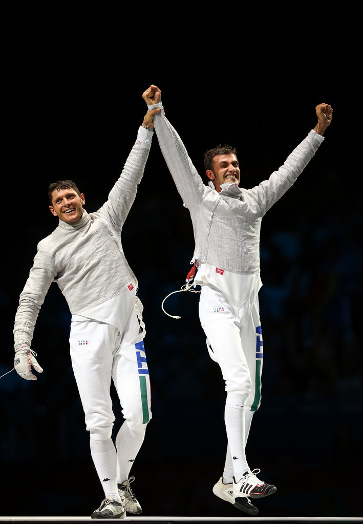 Fencers Aldo Montano and Luigi Samele of Italy showed their happy reactions after winning the bronze medal.