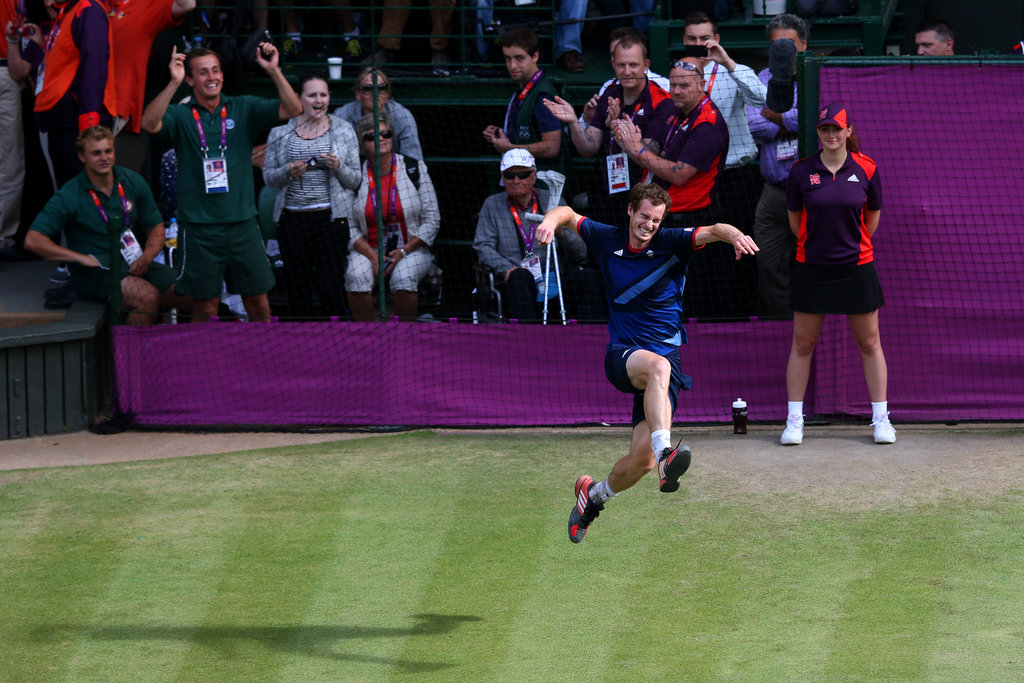 Great Britain's Andy Murray jumped for joy after defeating Roger Federer for gold in their singles tennis match.