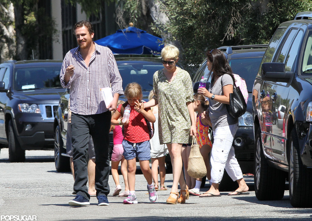Michelle Williams and Jason Segel held hands with Matilda on her way to gymnastics in LA.