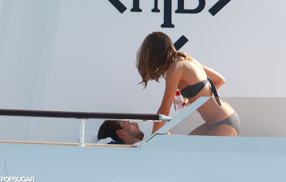 Olivia Palermo sat with boyfriend Johannes Huebl on board a yacht.