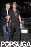 Johnny Depp walked into Aerosmith's afterparty in LA.