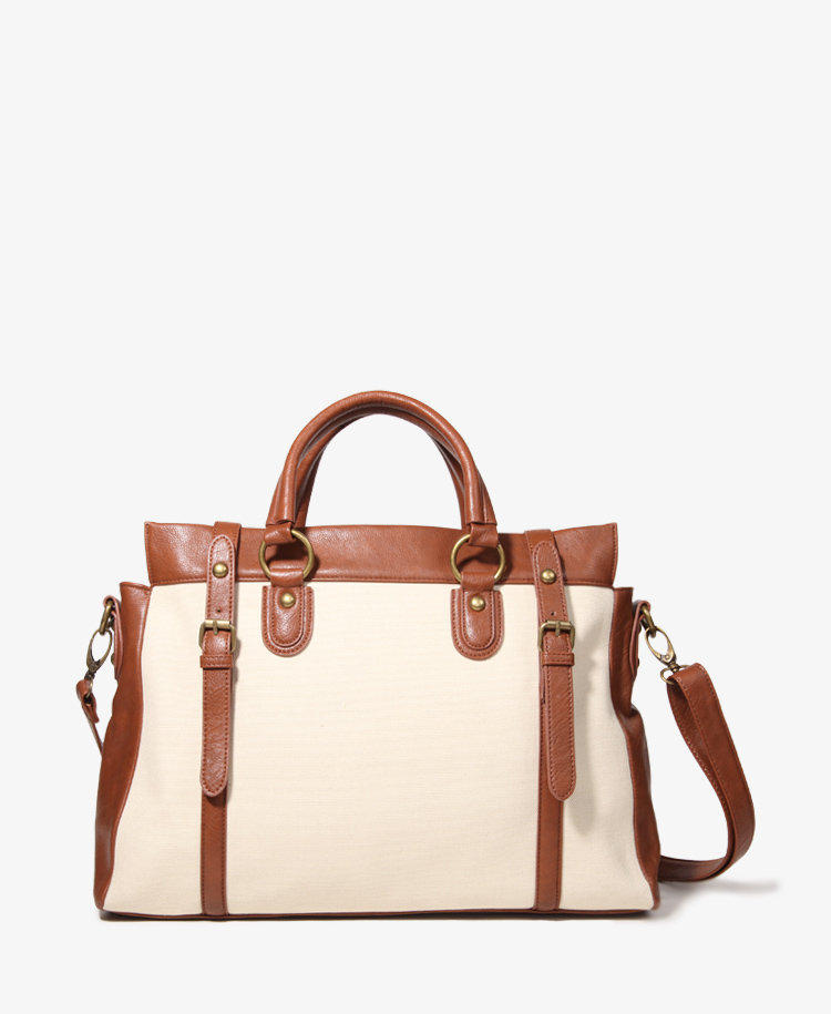 A lightweight canvas satchel with a sturdy crossbody strap? Sign us up. Forever 21 Buckled Canvas Satchel ($33)