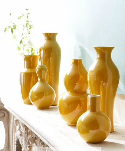 Rather than mixing a variety of colors and patterns, try to keep things sleek with a consistent shade. This set of yellow vases ($245) in varying sizes would add a rich, sunny look to any outdoor space.