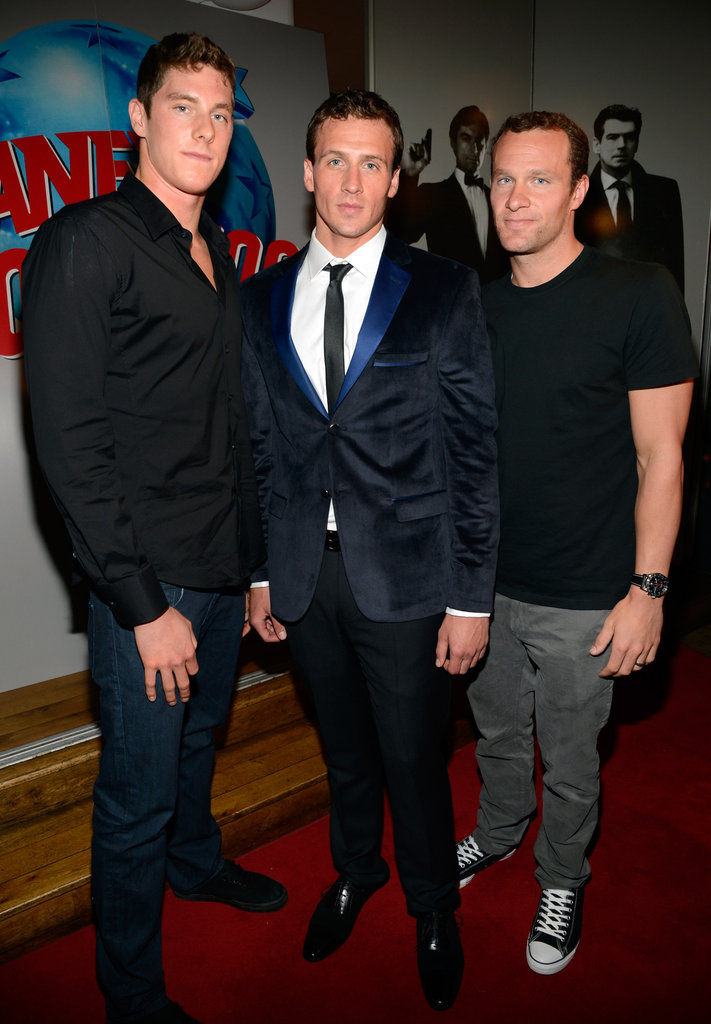 Ryan Lochte posed with friends at London's Planet Hollywood.