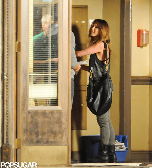 Jennifer Aniston Lets Her Bra Peek Through For Filming