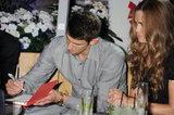 Michael Phelps signed an autograph at a party in London.