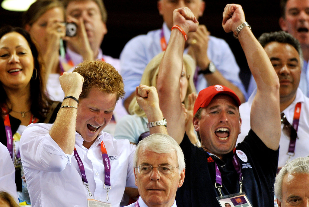 Prince Harry cheered at the velodrome with his cousin Peter Phillips.