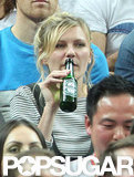 Kirsten Dunst watched the game as she sipped on a drink.