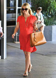 Reese Witherspoon wore a red dress and sandals.