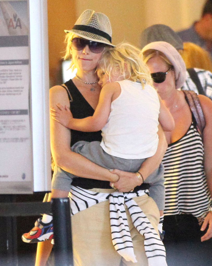 Zuma Rossdale cuddled close to mom Gwen Stefani at LAX.