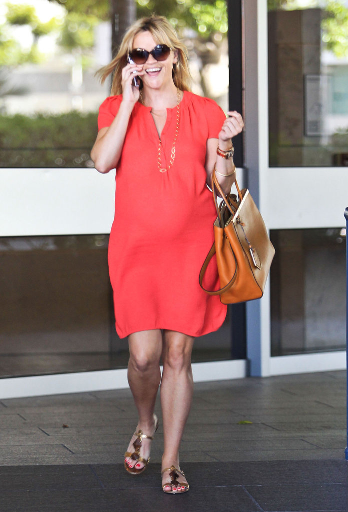 Reese Witherspoon laughed while talking on her cell phone.
