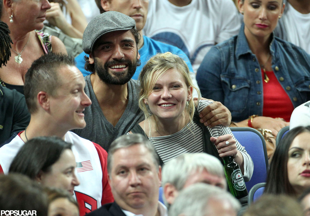 Kirsten Dunst had a drink in hand while watching the game.