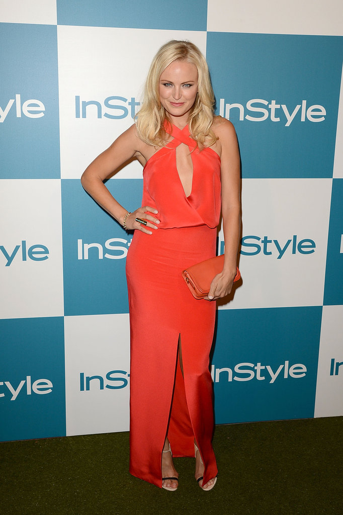 Malin Akerman vamped it up in a halter keyhole Cushnie et Ochs cutout dress in the silkiest blood orange hue.