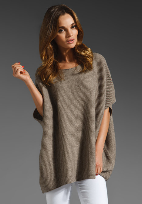 For cooler evenings, bundle up with a luxe poncho. The more layering options, the better. Vince Poncho Sweater ($320)