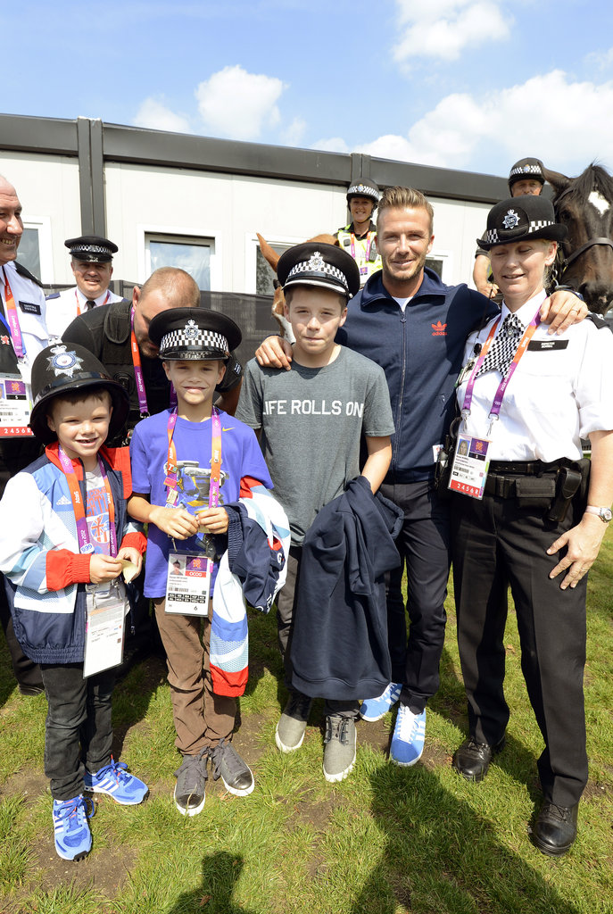 David Beckham brought his sons, Romeo, Cruz, and Brooklyn Beckham, to meet the Olympic security personnel.