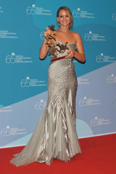 Jennifer Lawrence posed with the Marcello Mastroianni Award for best young actress for the movie The Burning Plain at the 65th Venice Film Festival Closing Ceremony in Venice, Italy, in September 2006.