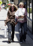 Portia de Rossi and Ellen DeGeneres had their hands full running errands in LA in June 2007.