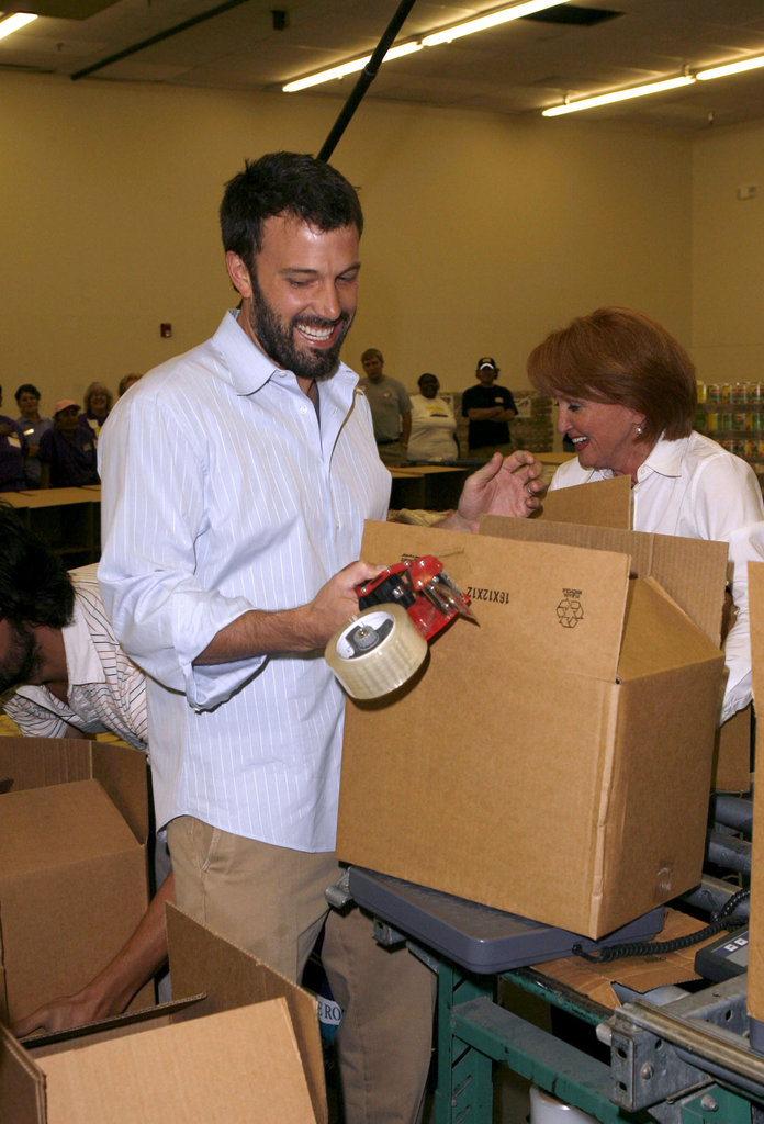 Ben Affleck laughed with fellow volunteers and boxed up food and supplies at the Send Hunger Packing charity event held in Denver, Colorado, in August 2008.