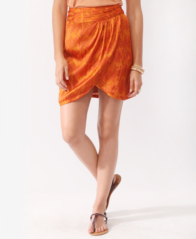 This orange wrap skirt hits on so many of this season's trends. Love 21 Abstract Tribal Print Wrap Skirt ($20)