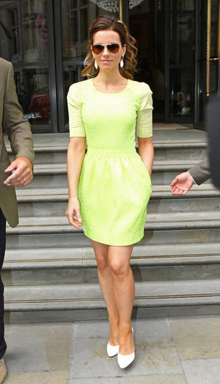 A bolder ensemble Kate wore in London was a neon lace Preen dress with white pumps, white drop earrings, and aviator sunglasses.  8310284