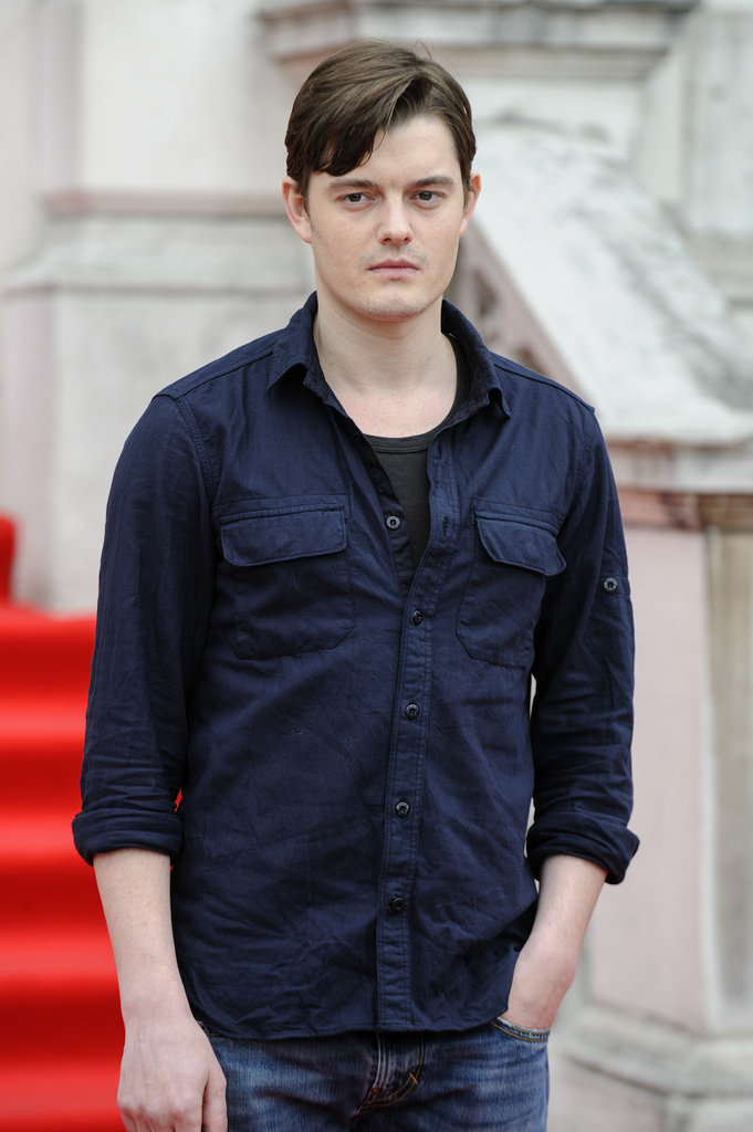 Sam Riley wore a blue button down.