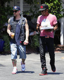 Joel Madden wore denim shorts.