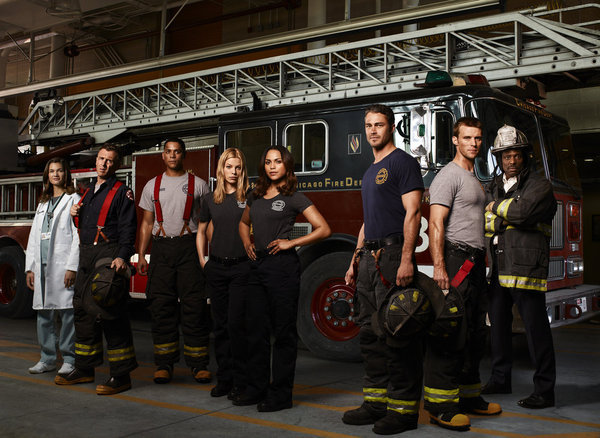 Teri Reeves, David Eigenberg, Charlie Barnett, Lauren German, Monica Raymund, Taylor Kinney, Jesse Spencer, and Eamonn Walker in Chicago Fire.