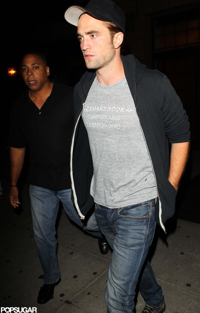 Robert Pattinson wore a black zip-up and hat for a night out in NYC.