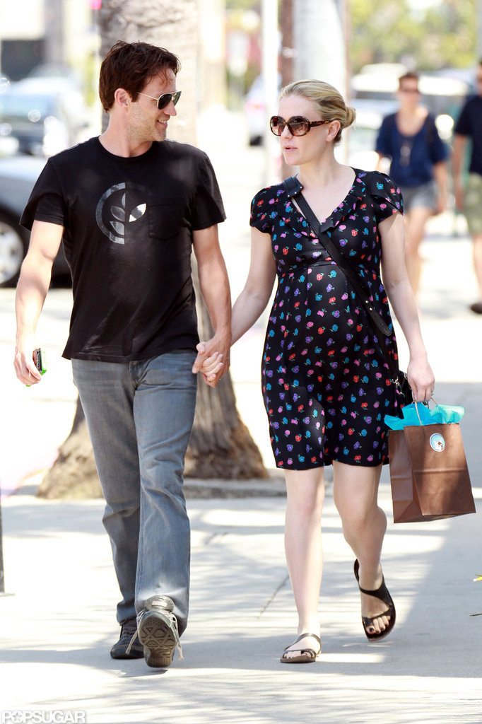 A pregnant Anna Paquin and Stephen Moyer held hands during a walk around LA in June 2012.
