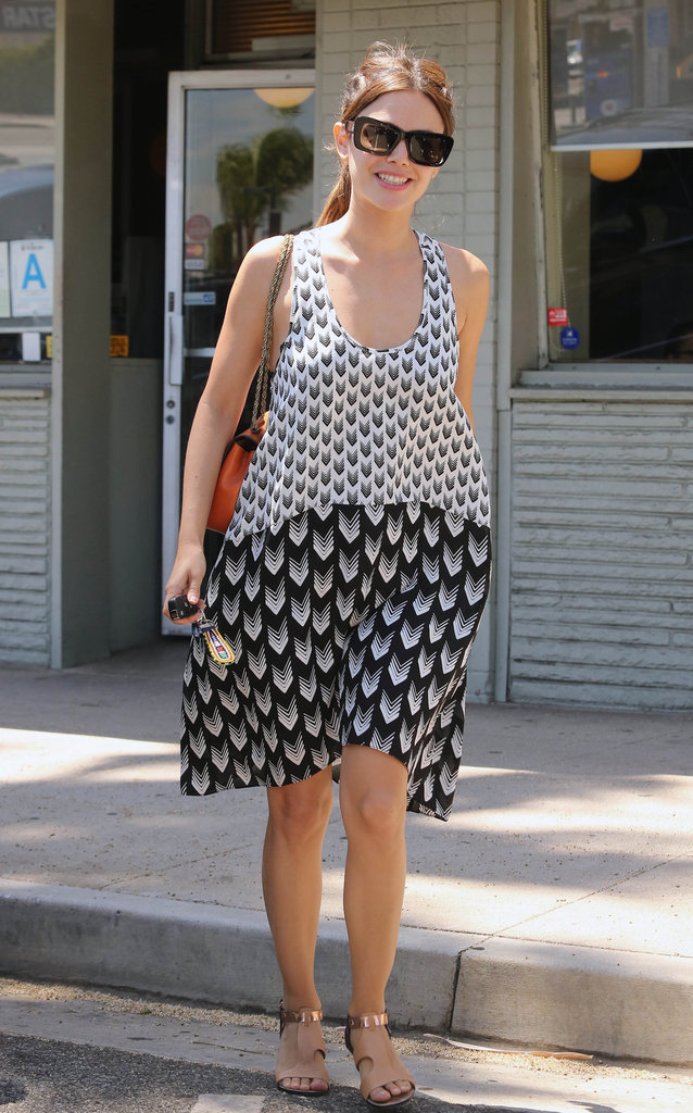 Rachel Bilson nailed the Summer prints look in a two-toned iteration by Rag & Bone. Her Rebecca Minkoff sandals and bold orange Chloé purse rounded out the look with a double pop of color.