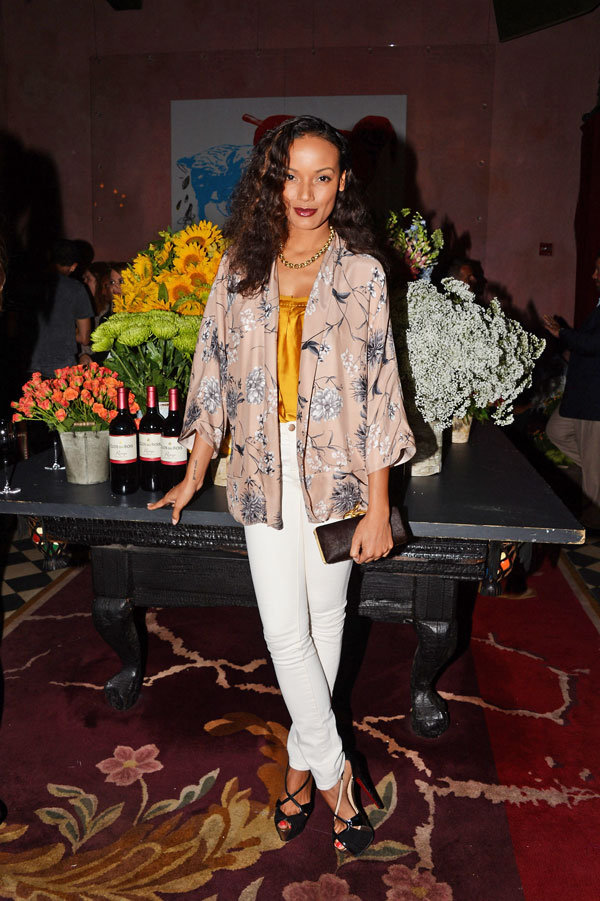 Selita Ebanks put a cool evening spin on her white denim look by adding a silky yellow-toned top and a printed chinoiserie-inspired jacket into the mix.