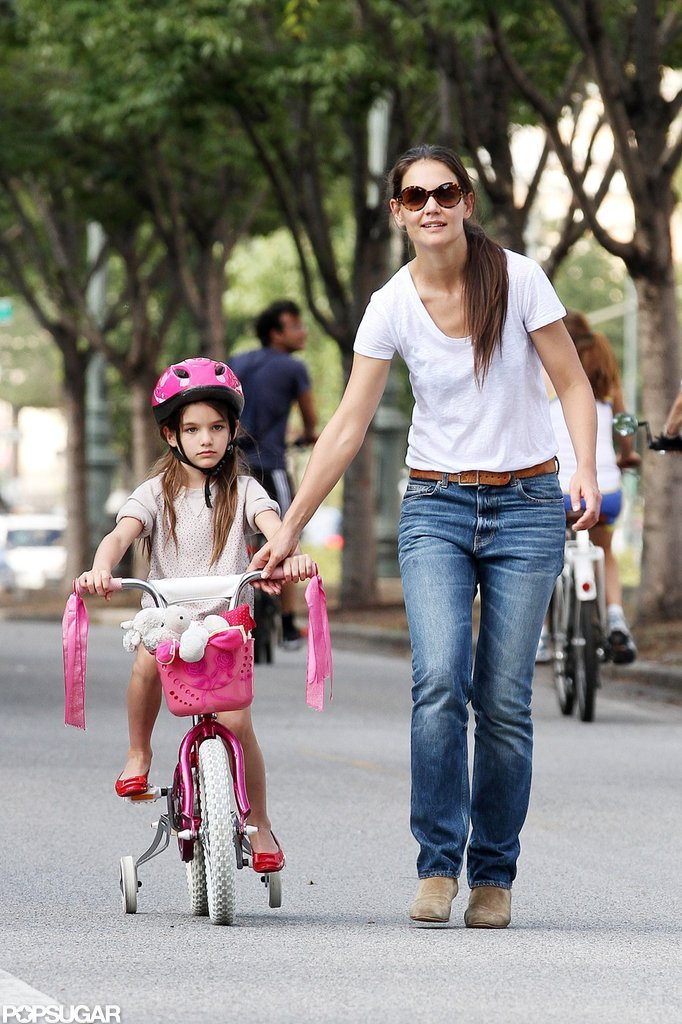 In August, Suri Cruise learned how to ride a bike under the watchful eye of mom Katie Holmes in NYC.