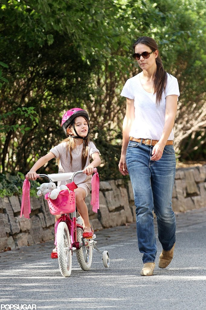 Suri Cruises Around on Her Hot Pink Bike — With Training Wheels!