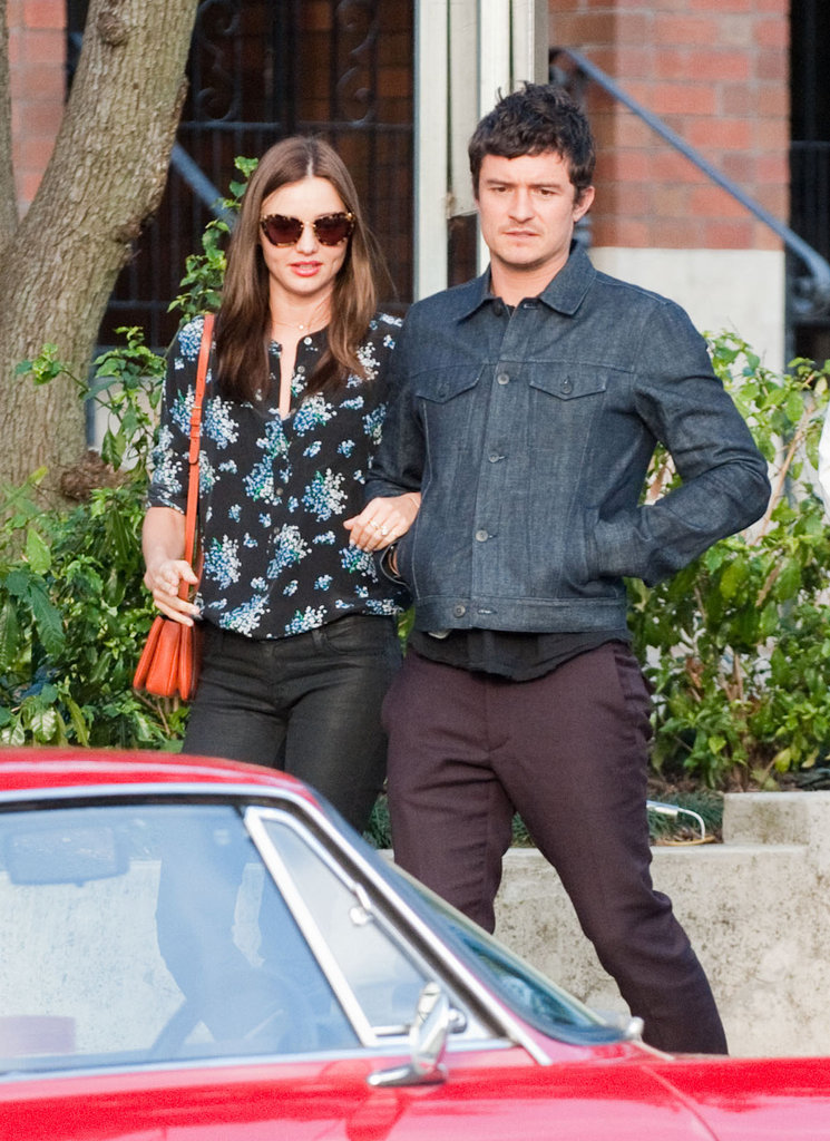Miranda Kerr and Orlando Bloom held on to each other during a walk in Sydney.