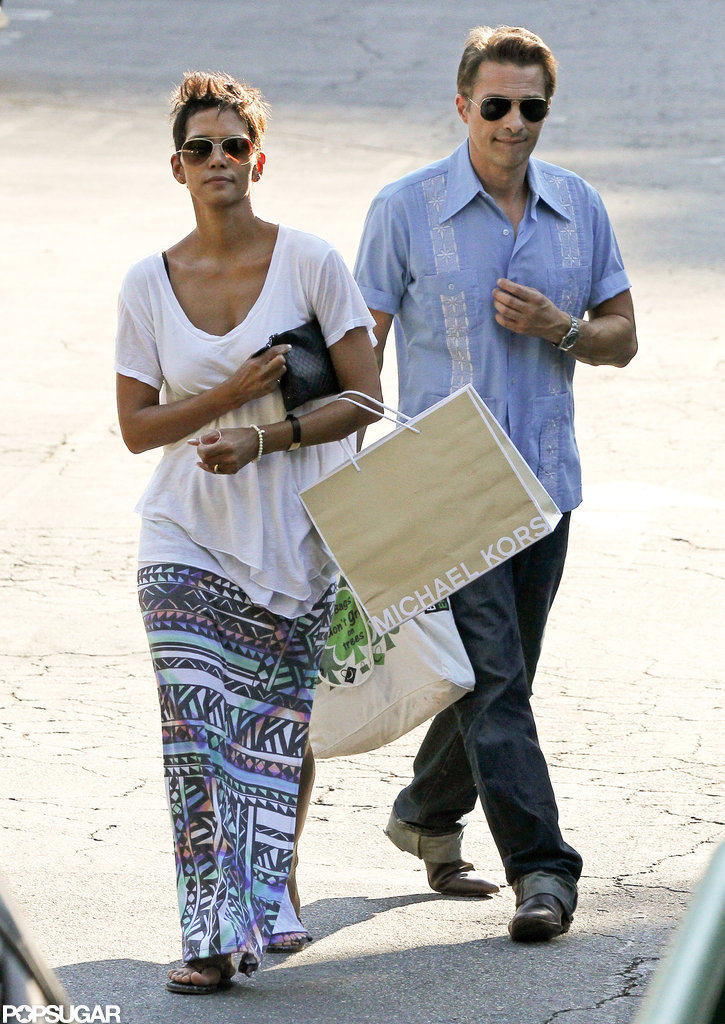 Olivier Martinez accompanied Halle Berry on a birthday shopping trip in LA in August 2012.