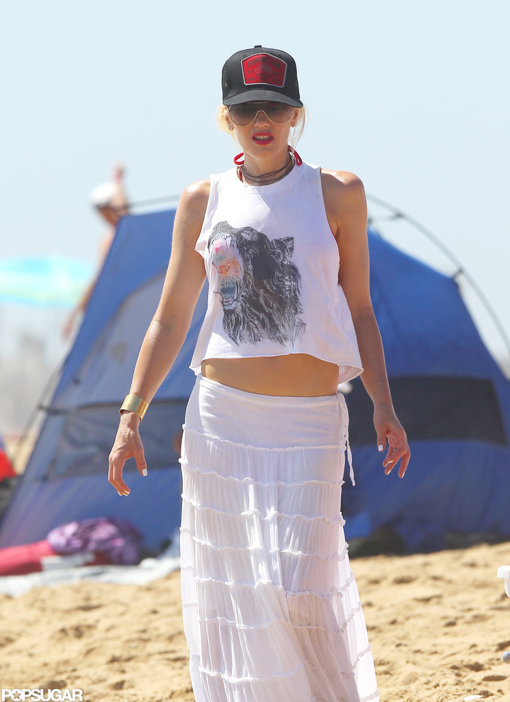 Gwen Stefani wore a red bikini under her tank top on the beach.