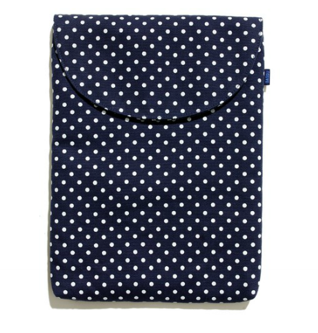 We love the feel of a pretty polka-dotted laptop sleeve to accent your stack of study-savvy pieces. Baggu Laptop Sleeve ($36)