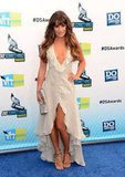 Lea Michele took the plunge (literally) in a deep-V, ruffled neckline dress, courtesy of Giorgio Armani. The off-white creation also showed off her legs, revealing sexy snakeskin sandals by Jenni Kayne. Her Fendi clutch provided that final pop of sparkle.