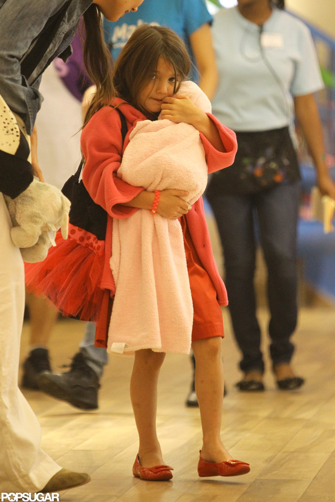 Suri Cruise held her baby-doll close.