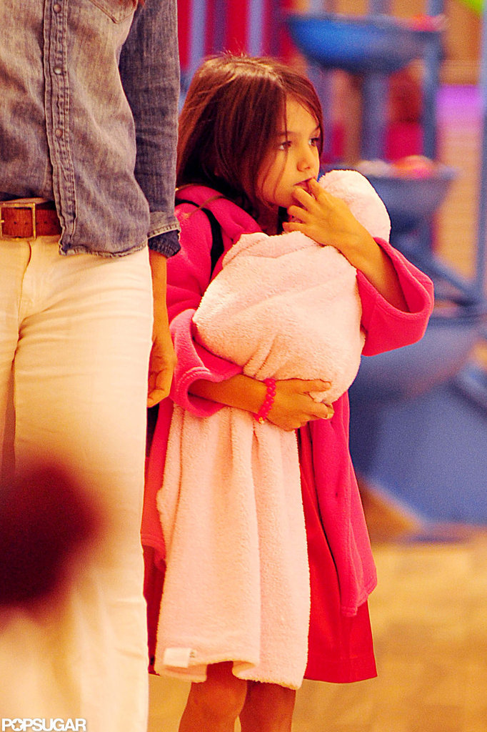 Suri Cruise took her baby-doll on a shopping trip in NYC.