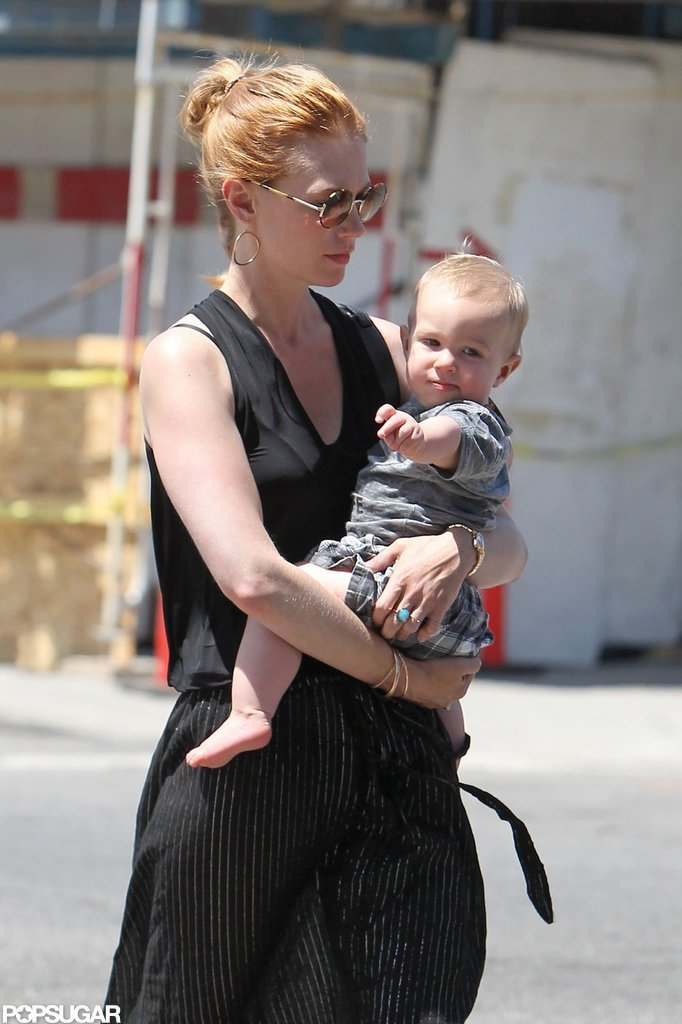 January Jones carried Xander while wearing all black.