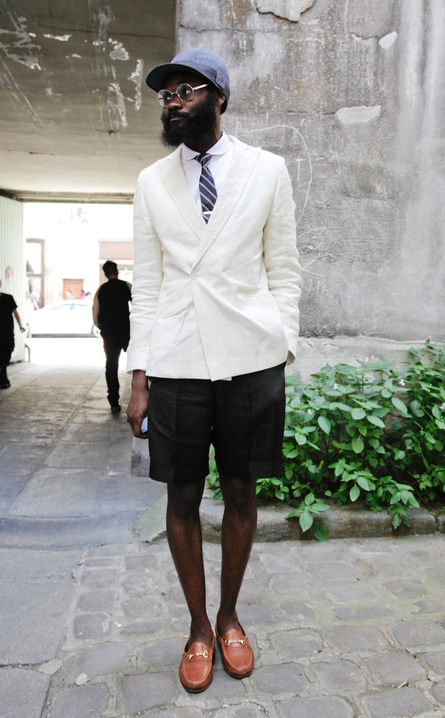 What makes this dude so cool? If you ask us, it's all about that juxtaposition between pulled-together and laid-back — the sophisticate with a sporty side. Channel the effect with preppy pieces like a blazer and loafers, then add in a baseball hat to perfect the style. 8391496 Source: Stylesight