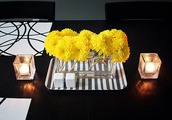 Use a basic tray to make a floral arrangement pop! Pairing bright yellow flowers against a black-and-white tray as seen in this CasaSugar Community Post makes for a great centerpiece.