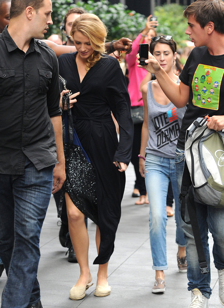 Blake Lively made her way to the set to film in a black robe.